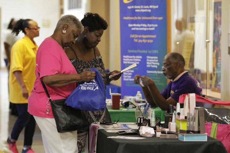 Attendees receive informational materials at the 2017 community health fair, organized by 100 Black Men of Metropolitan St. Louis.