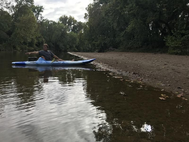 Bonne Terre resident Steven Anderson sits in a kayak in the Big River next to a beach covered in legacy mine waste.