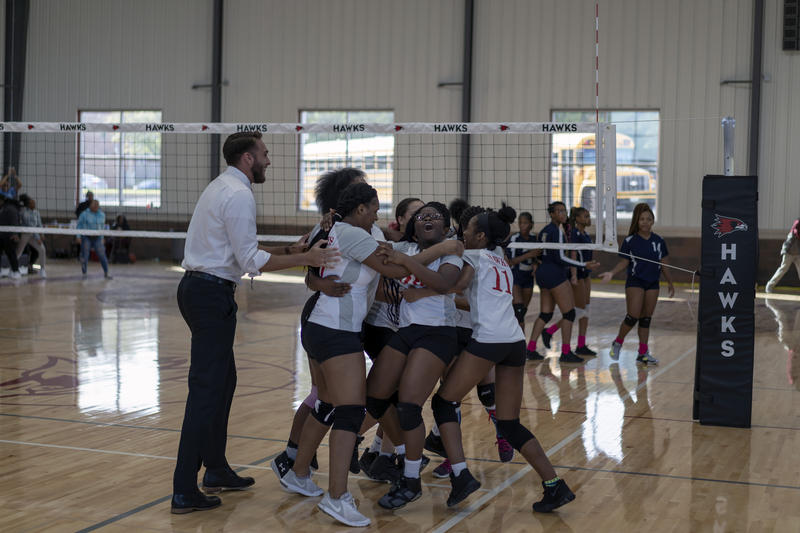 The junior varsity girls' volleyball team celebrates winning a game against Clyde C. Miller Academy Wednesday, Sept. 26, 2018.