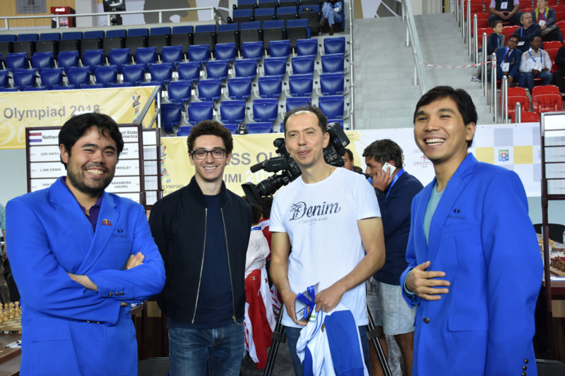 "The American ""Big Three"" at the Batumi Chess Olympiad in Batumi, Georgia in 2018. From left, Hikaru Nakamura, Fabiano Caruana, Caruana's coach and Wesley So."