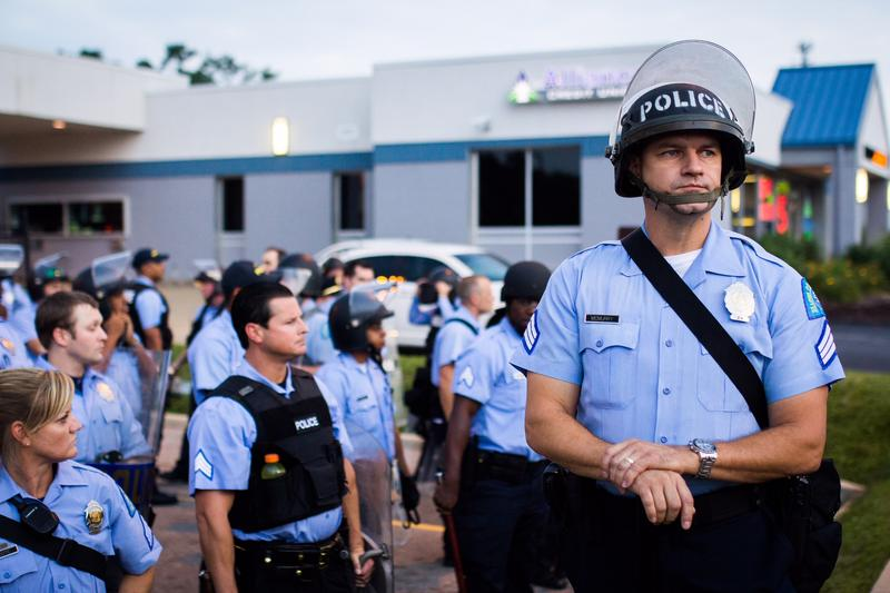 Police officers stand by in this photo taken during the 2014 protests in Ferguson.