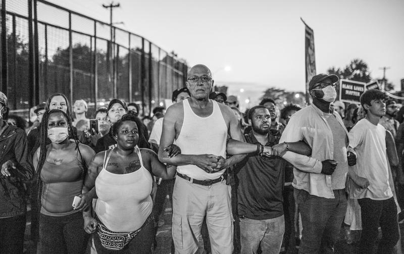 Protesters lock arms as they block traffic on Forest Park Parkway as part of the 2017 protest against the acquittal of Jason Stockley.