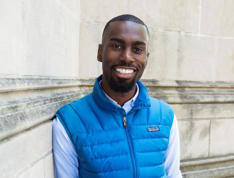 DeRay Mckesson poses in the trademark blue vest that he first wore in the early days of the Ferguson protests.