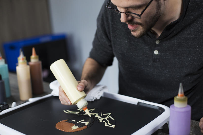 Daniel Drake creates pancake art using a grill from Dancakes' griddle kit.