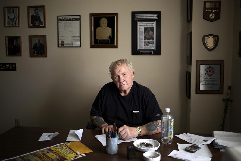 Harley Race poses for a portrait after responding to letters at his Harley Race Wrestling Academy office in Troy.