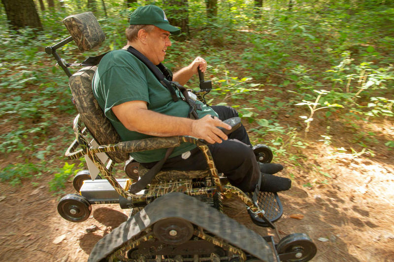 Ray Schultz, a Missouri Department of Conservation volunteer, is riding an Action Track Chair.