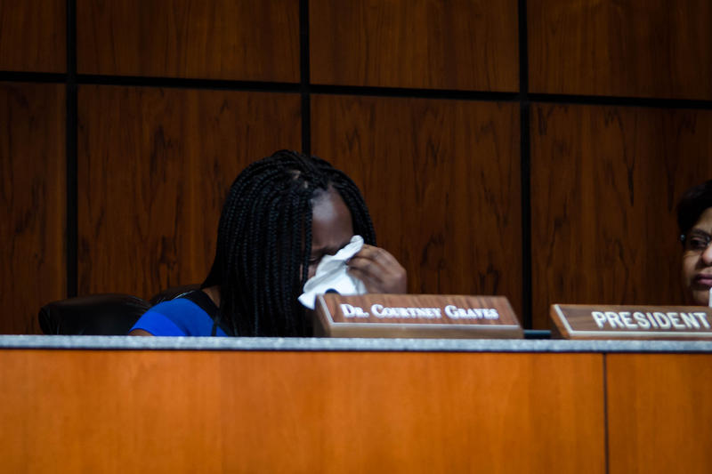 Ferguson-Florissant Board of Education President Courtney Graves wipes tears Wednesday, Oct. 10, 2018, while discussing options for closing schools in the district.