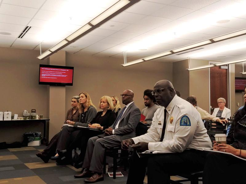 St. Louis Police Chief John Hayden (right) listens on October 11, 2018 along with public safety director Jimmie Edwards and Mayor Lyda Krewson as researchers outline their findings on enforcement rates in St. Louis.