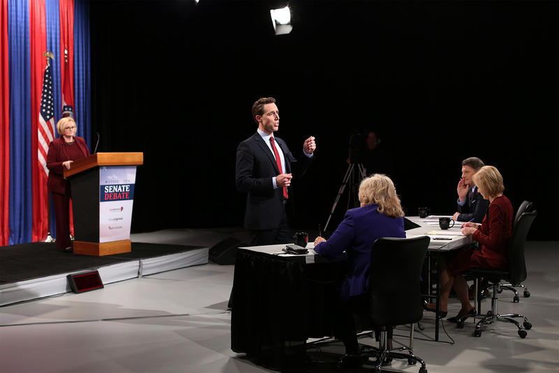 Missouri Attorney General Josh Hawley answers an audience member's question during a televised senatorial debate on Thursday.
