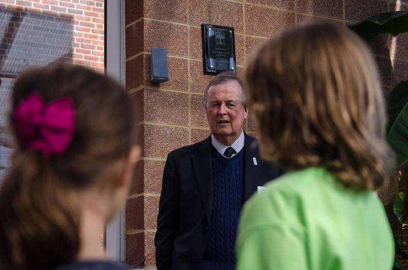 Interim Education Commissioner Roger Dorson listens to a student presentation during a tour of The College School in Webster Groves Oct. 24, 2018. Dorson is a contender to run the Missouri Department of Elementary and Secondary Education permanently.