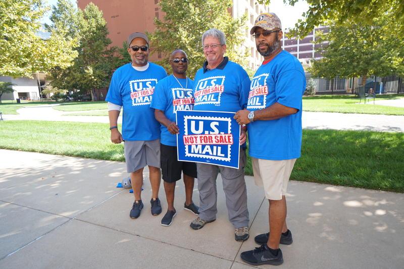Members of National Association of Letter Carriers rallied against privatization of the U.S. Postal Service in cities around the country including St. Louis on Monday.