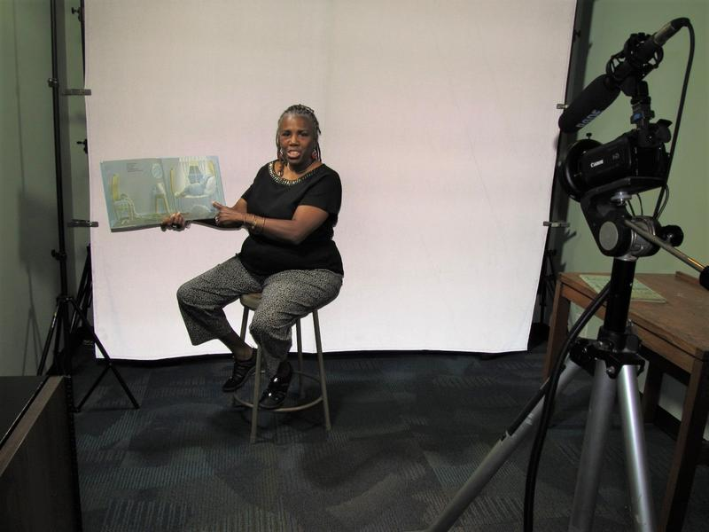 Assistant Children's Librarian LaRita Wright uses the library's video studio to record a storytime session.
