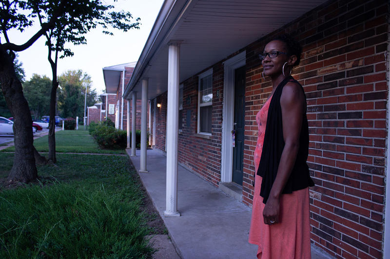 January Harris is fully employed but relies on Section 8 housing vouchers to live in a sub-standard apartment.