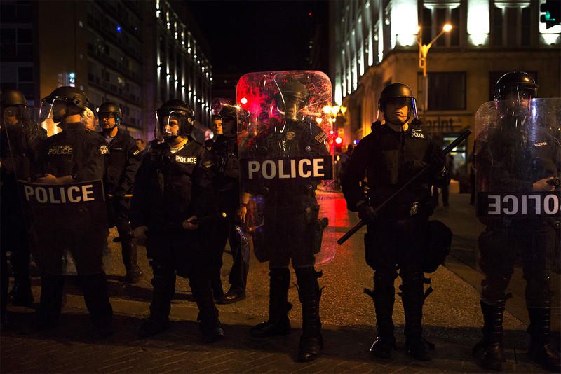 Police officers line up on Washington Ave. in downtown St. Louis on Sept. 28, 2018 as people protest against the Stockley verdict and against mass arrests during a protest the previous week.
