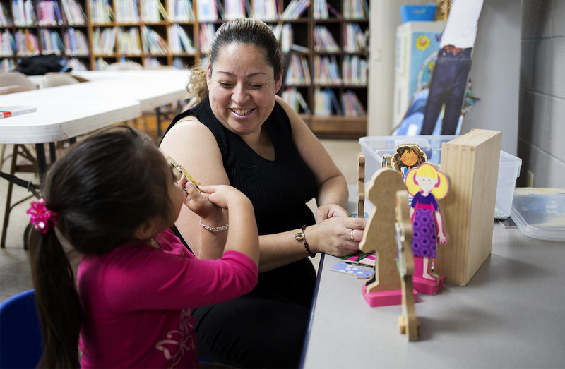 Families gather at the Fairmont City libary to play, read books and take classes.