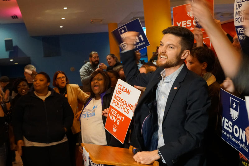 Benjamin Singer, communications director for Clean Missouri, announces victory in the contest to pass Amendment 1 to supporters at Flamingo Bowl in St. Louis.