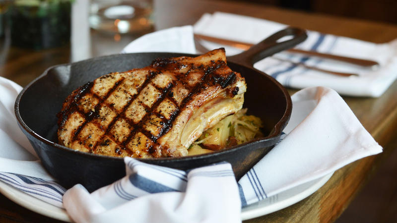 A porkchop is among the offerings at 58hundred, one of five new area restaurants on this month's Hit List.
