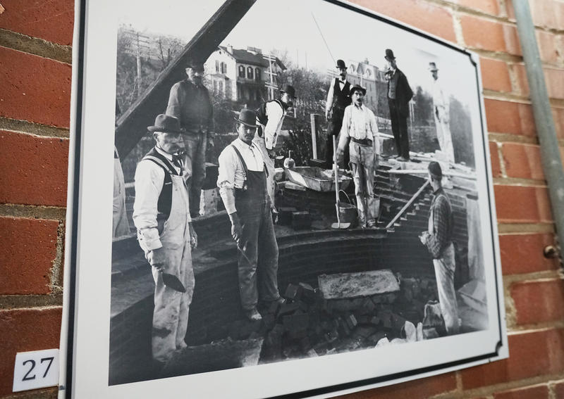 Construction workers lay the brickwork for the Compton Hill water tower.