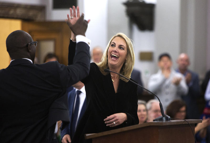 Carolyn Kindle Betz and St. Louis Board of Aldermen Presidet Lewis Reed high five after members of the Housing, Urban Development and Zoning Committee expressed support for a plan to bring a Major League Soccer stadium to St. Louis.
