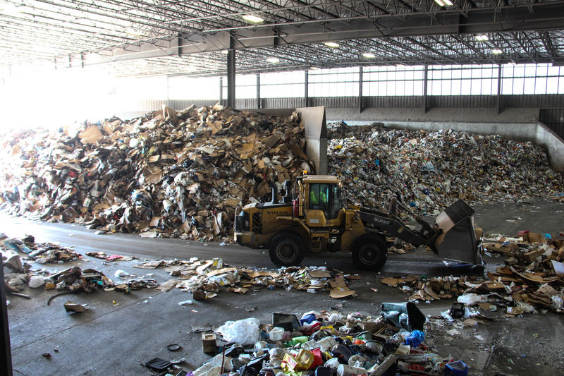 "The ""tip room"" at Republic Services' processing plant in Hazelwood, where trucks bring in recycling."