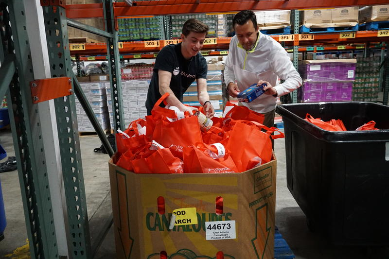 Nov. 19, 2018 at Operation Food Search: Andrew Glantz, CEO GiftAMeal and food bank manager Mark Taylor check bags for weekend meal program.