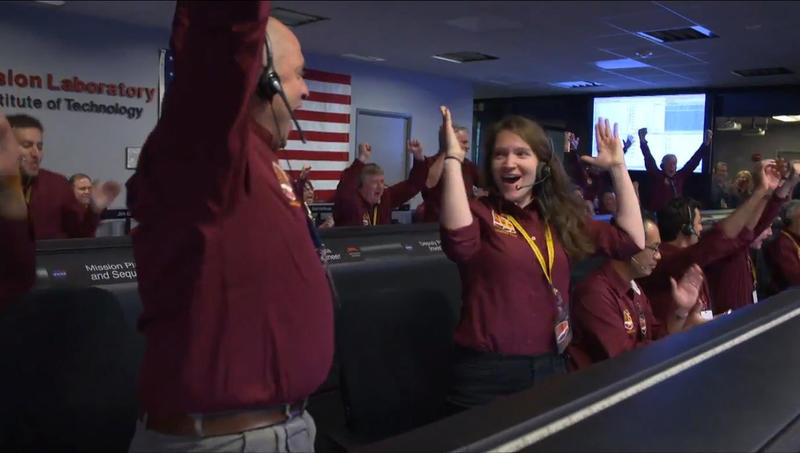 NASA engineers celebrating the successful landing of the Mars Insight spacecraft at the Mission Support Area in Pasadena, California on Nov. 26, 2018.