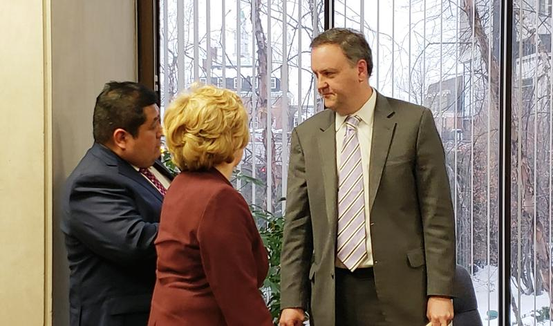 St. Louis County Councilman Sam Page, a member of the council's ethics committee, talks to St. Louis County Economic Development Partnership board members Karlos Ramirez, left and Kathy Osborn, center, after the two testified to the committee on Jan. 15,