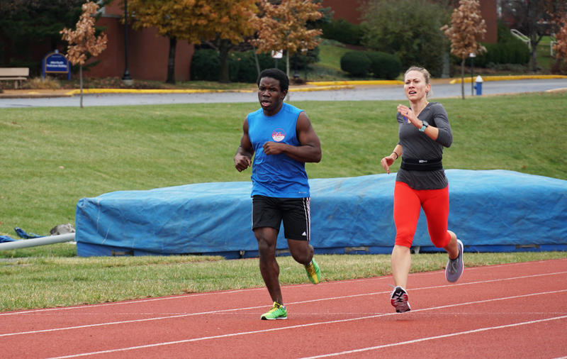 Nick Silver and Liz Houghton run 200-meter sprints at the St. Louis University Track on December 1, 2019.
