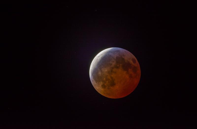 The moon passes through Earth's shadow on Sunday night, Jan. 20, 2019.