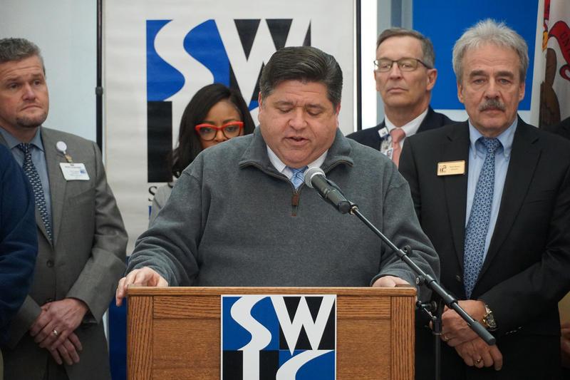 Gov. J.B. Pritzker addresses students and community leaders at Southwestern Illinois College in Belleville.