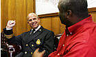 St. Louis Public Safety Director Charles Bryson (R) talks with acting fire chief Steve Kotraba after Kotraba was appointed to fill the post Monday (UPI photo/Bill Greenblatt)