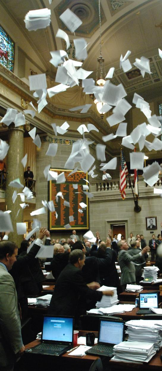 Memebers of Missouri House toss paper in the air as the 2009 session is adjourned sine die.