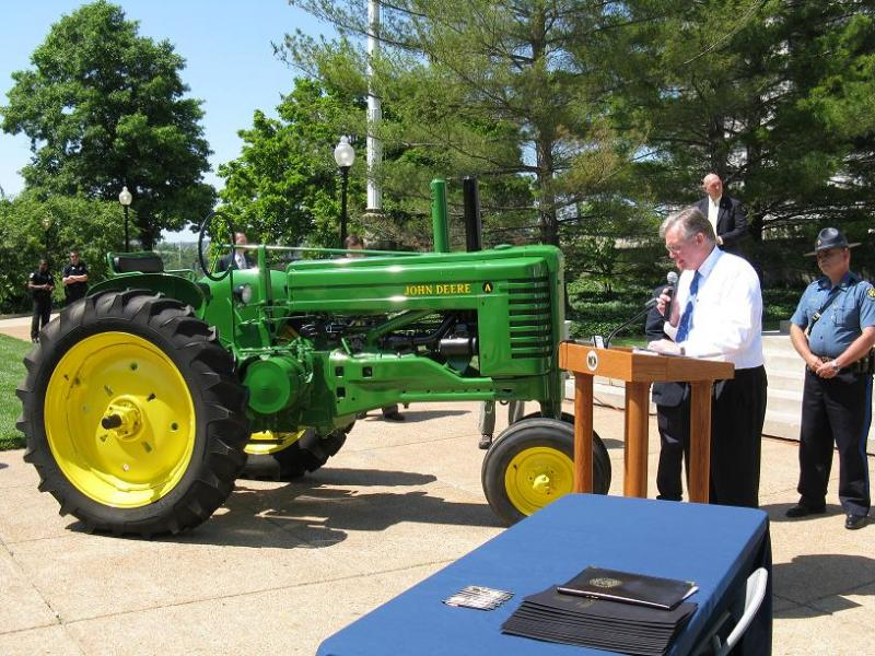 Gov. Jay Nixon at a bill signing ceremony at the State Capitol, legalizing tractor parades.