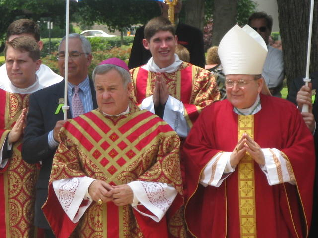 Archbishop Carlson (left), Archbishop Raymond Burke (left)