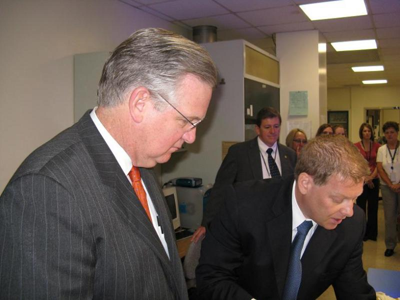 Mo. Gov. Jay Nixon tours State Crime Lab before a bill signing ceremony.