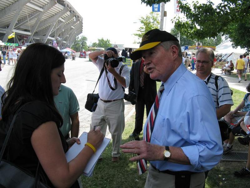 U.S. Senator Kit Bond talks to reporters at the Mo. State Fair in Sedalia.