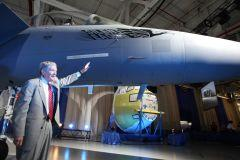 Sen. Kit Bond looks over F-15 at Boeing's 70th anniversary celebration
