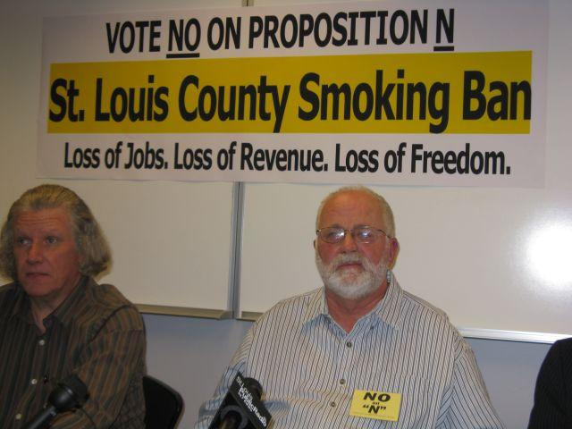 Scott Simon, Greater St. Louis Bowling Proprietors Association, and Jon Rand, Discount Smoke Shops, attend a press conference in University City Wednesday.