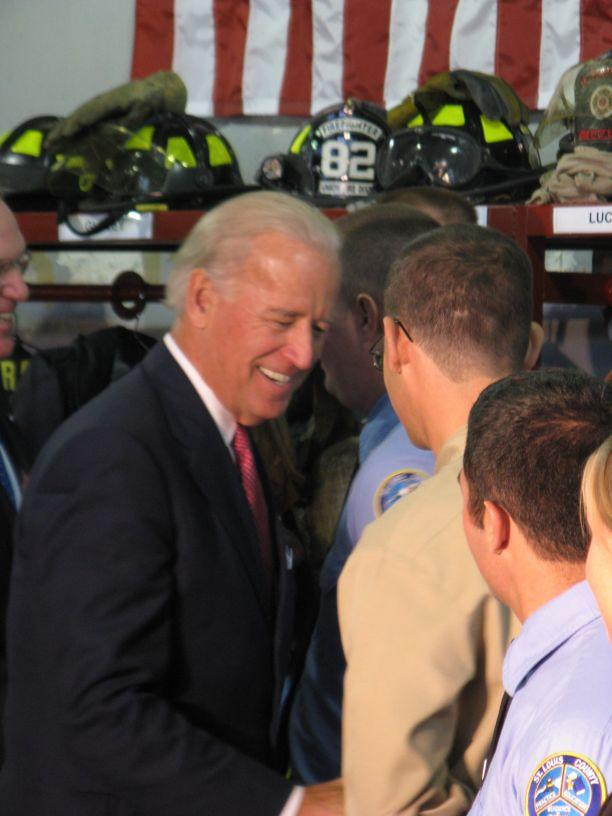 Vice President Joe Biden greets police and fire recruits during a visit to St. Louis