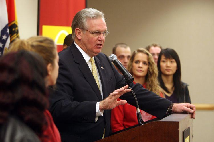 Students from the University of Missouri-St. Louis listen as Gov. Jay Nixon announces an agreement to limit state higher ed funding cuts to 5% in exchange for a tuition freeze. (UPI photo/Bill Greenblatt)