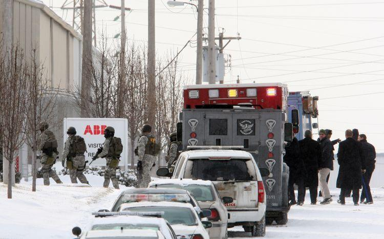 FBI agents enter the ABB Industries plant in north St. Louis. Four people were killed and five wounded in a morning shooting at the plant, which makes electrical transformers