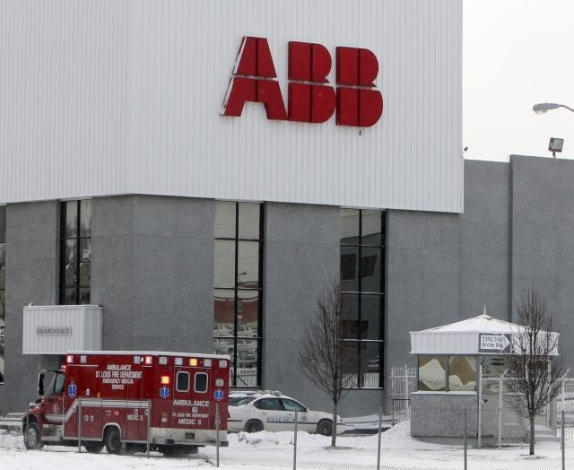 An ambulance waits outside the ABB plant in north St. Louis after the Jan. 7 shooting. (photo: UPI/Bill Greenblatt)