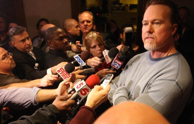 Mark McGwire meets reporters in a hallway after his appearance at the Cardinals Care Winter Warm Up on Sunday. McGwire made his first appearance since admitting he used steroids during his career. (photo: UPI/Bill Greenblatt)