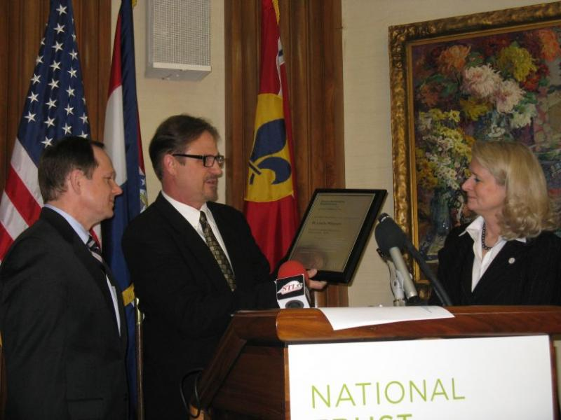 "Mayor Francis Slay (left) and Convention and Visitors Commission president Kitty Ratcliffe accept the plaque designating St. Louis as one of a ""Dozen Distinctive Destinations\"""