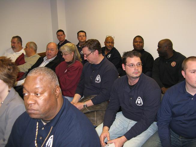 Several St. Louis police officers attend a Mo. House committee meeting at the State Capitol.