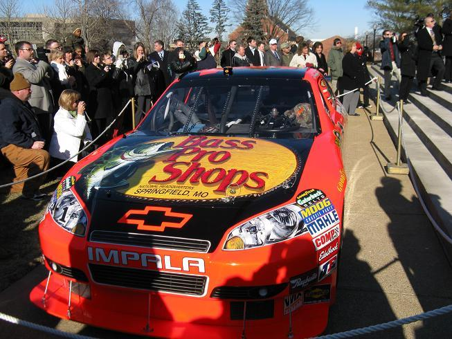 A replica of the race car Jamie McMurray used to win the 2010 Daytona 500 sits at the foot of the steps of the Mo. Capitol.