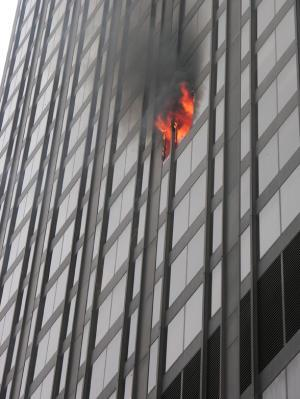 Flames shoot out of a window at 720 Olive, which houses offices for Laclede Gas
