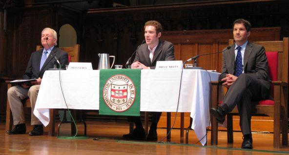 Debaters Fred Palmer (left) and Bruce Nilles (right), with moderator Bryan Walsh.