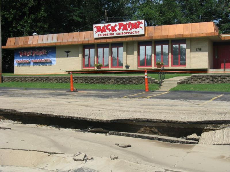 Wednesday's flash floods buckled this parking lot outside Sciortino's Chiropractic