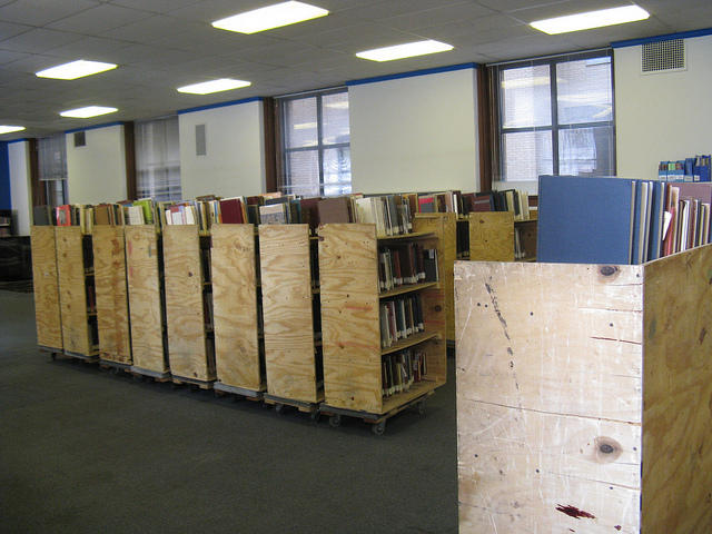 Stacks of books from the Central library downtown wait to be loaded onto moving vans